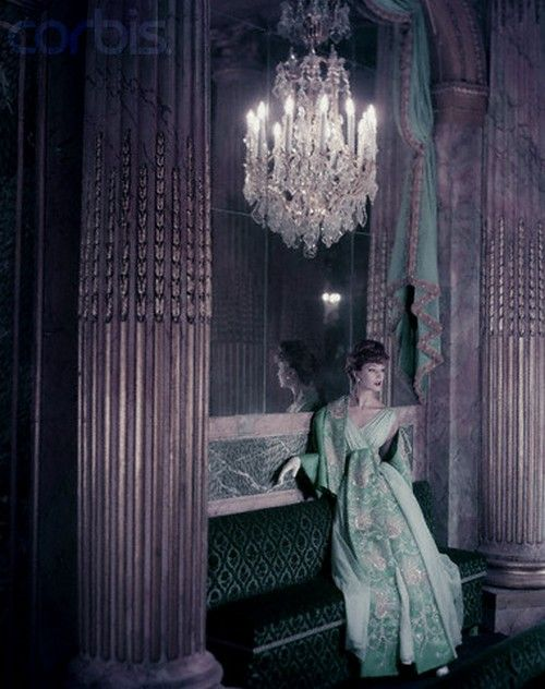Model in a gold embroidered turquoise Lanvin-Castillo gown in the Theater of King Louis XV at Versailles. Photo by Henry Clarke.