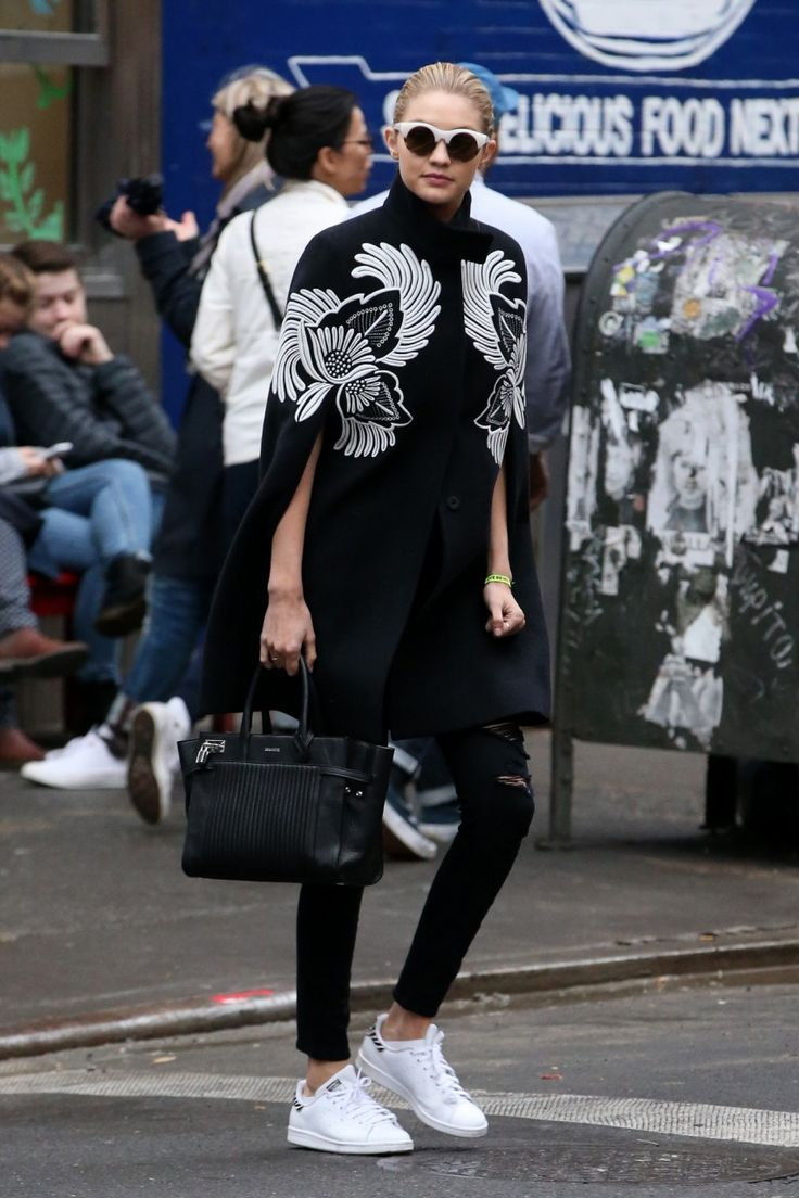 Gigi Hadid.. Stella McCartney Cape, Joe's Jeans, Adidas Stan Smith Sneakers, Elizabeth and James Sunglasses, and Zadig Et Voltaire Candide Bag..