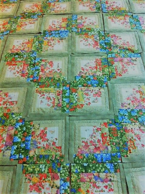 http://www.quiltingboard.com/pictures-f5/finally-finished-my-floral-log-cabin-blocks-t287898.html
