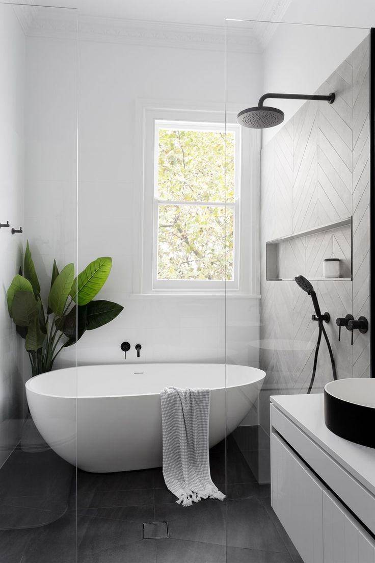 Minimal bathroom design | white bathroom with indoor plant, natural light, and black accents | Minimal home design inspiration | #minimalbathroom