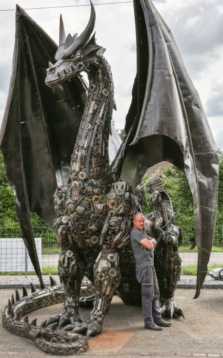 Recycle Artwork Dragon by Tom Samui 5M excessive and comprised of automotive and bike elements