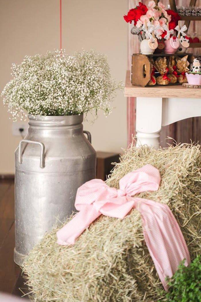 Giant milk jug filled with Babies Breath + Hay Bail from a Girly Little Farm Birthday Party via Kara's Party Ideas   KarasPartyIdeas.com (10)