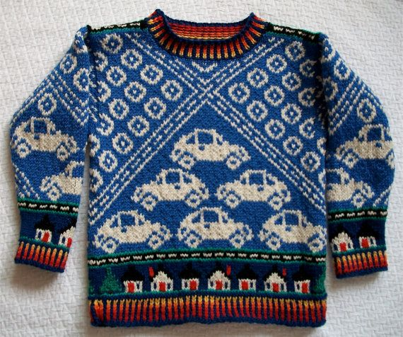 A more traditional design for Beetles, in white on periwinkle. The main body of the design is Beetles and roads and tires. The identical sleeves. Kerry Fletcher-Garbisch. 2-14 years