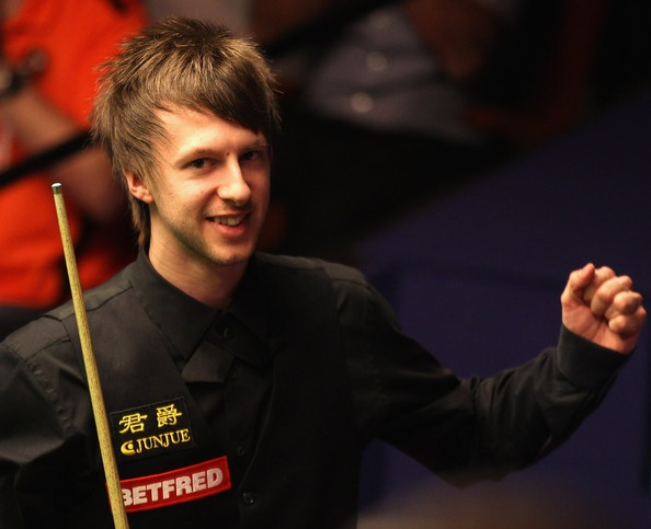 Judd Trump of Great Britain celebrates beating reigning champion Neil Robertson of Australia in the first round on day one of the Betfred.com World Snooker Championship at The Crucible Theatre on April 16, 2011 in Sheffield, England.