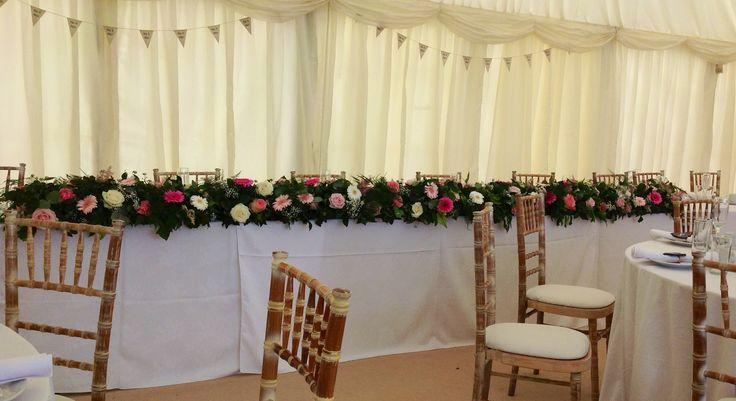 A stunning and very long top table design with pinks and creams... It was as wide as the shop!
