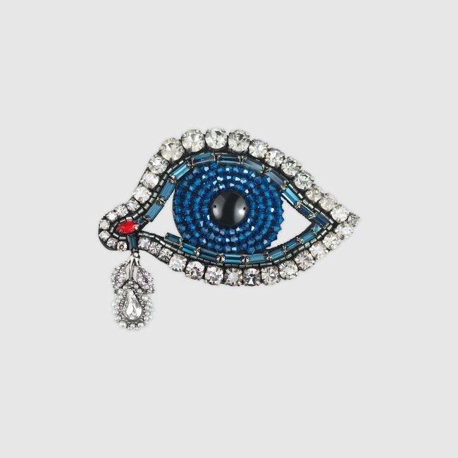 Gucci eye brooch with Swarovski crystals.