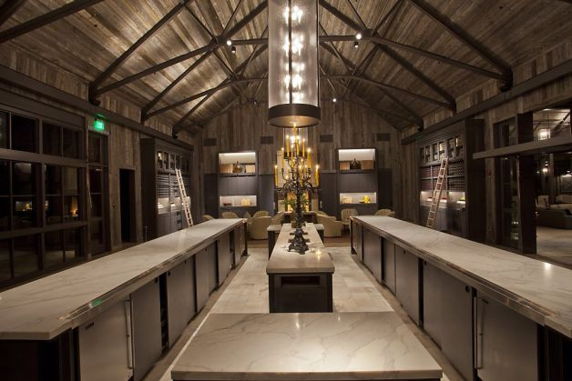 Ram's Gate Winery in Sonoma opened to the public in September 2011 after a year-long construction project guided by architect Howard Backen, with interior design by Orlando Diaz-Azcuy. Here, we see the wine-tasting room, with two tasting counters made of 3-inch white Calcutta marble, and wine refrigerators below. The room is enhanced by two 38-inch bronze candleabras with 13 black candles each. The floor is colored cement, except for under the tasting areas, where recycled white Calcutta…