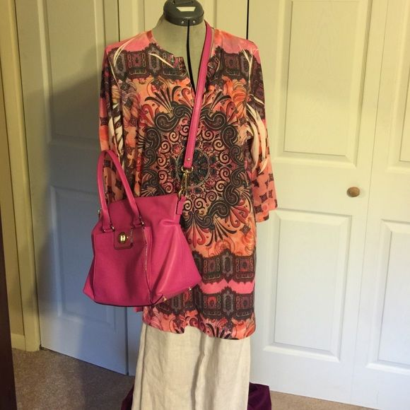 Chico's hippie style tunic. You will love this beautifully designed top with lots of hip style. Main colors are peach, brown, pink. Chico's Tops Tunics