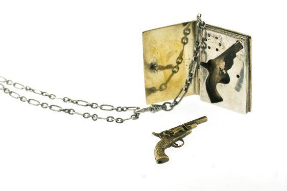 Miniature book locket containing a tiny revolver