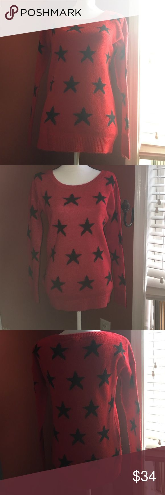 Express sweater size small. NWOT. Red sweater with black stars. Tried on-never worn. Taken to the dry-cleaners to sell as it sat in my closet for two years. Acrylic, nylon, wool and mohair. Very cute, soft and fitting. NWOT Express Sweaters Crew & Scoop Necks