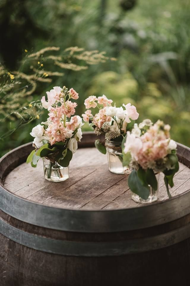 Jam jars with blush stock and garden roses