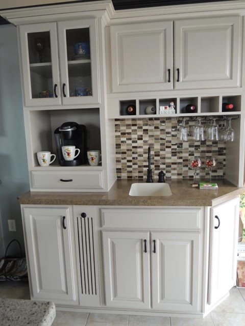 drink station. WOW does this makes sense! Coffee and all the endless drinking cups all over the kitchen!