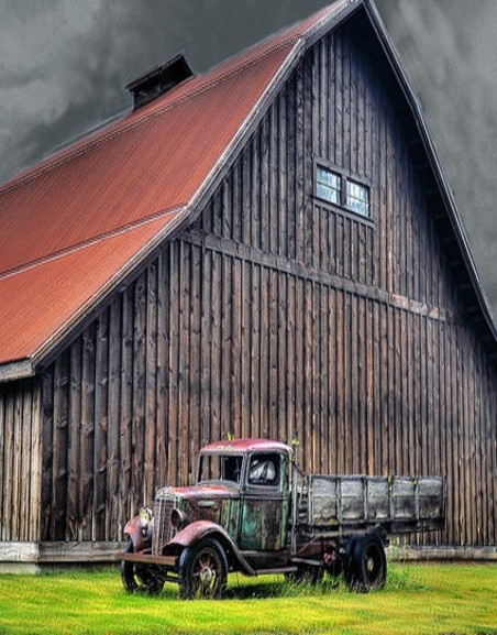 I don't know which is more awesome, the barn & truck or the sky above looking as if a tornado's going to strike any minute!