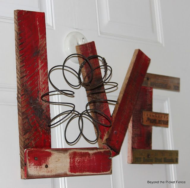 Valentine Decor / Craft ~ door hanging rather than wreath - wood scraps, ruler section, old spring ~ Beyond The Picket Fence: A Little More Love