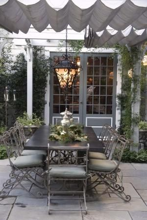 """Heather Lenkin took an old driveway behind one of the earliest farmhouses in the Los Angeles area and transformed it into a Victorian-inspired outdoor living area. <a href=""""http://www.gardendesign.com/articles/romantic-outdoor-kitchen-heather-lenkin"""">Click here to read the full story</a>."""