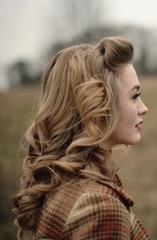 I wish I could find a less pixelated photo. I love her 1940's hair with its classic blonde... The waves and pin curls...paired with the setting...she is timeless.