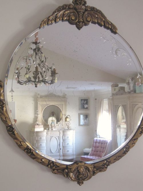 I have a weakness for gorgeous old mirrors... I have to many in my house :)