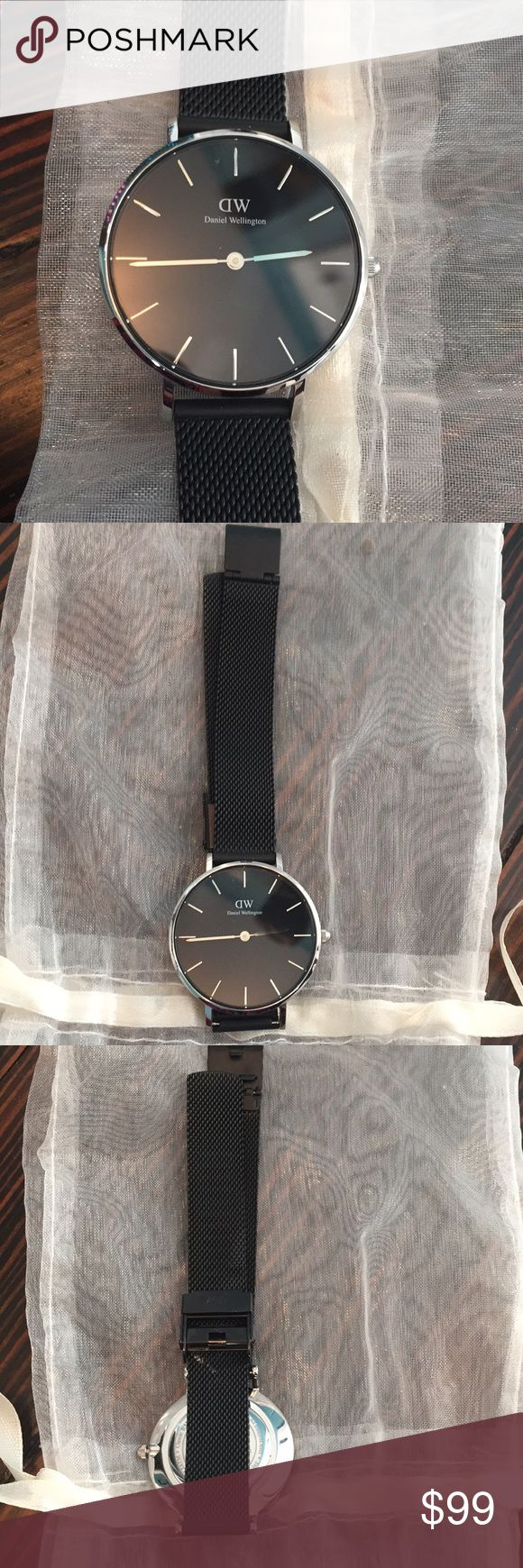 Daniel Wellington Ashfield Petite Stainless Watch In excellent preowned condition  Battery still works Small scratch on band (see pic)  Daniel Wellington stainless steel watch Deployment fastening Stainless steel case, black dial, branding at dial, Japanese quartz movement, mesh strap Case diameter: 32mm Water resistance: 30m Daniel Wellington Accessories Watches