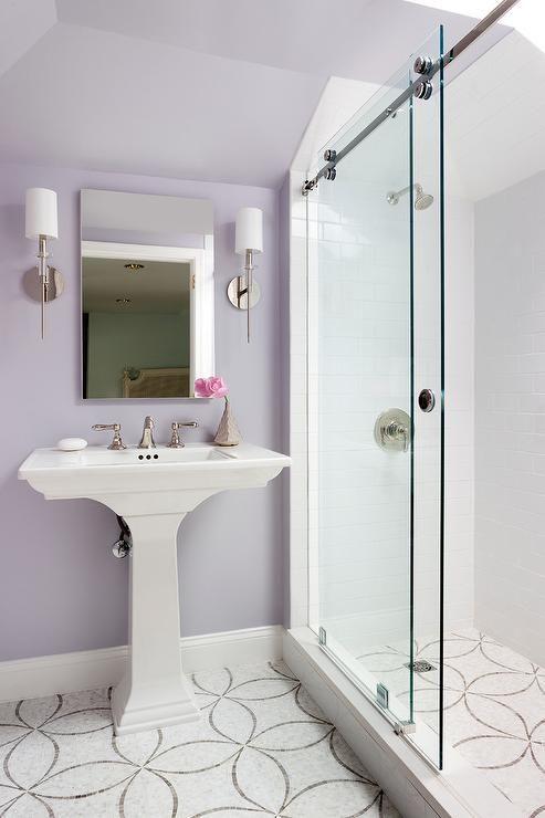 Charming Lavender Bathroom Features Ann Sacks Chrysalis Tiles Positioned  Beneath A White Pedestal Sink.
