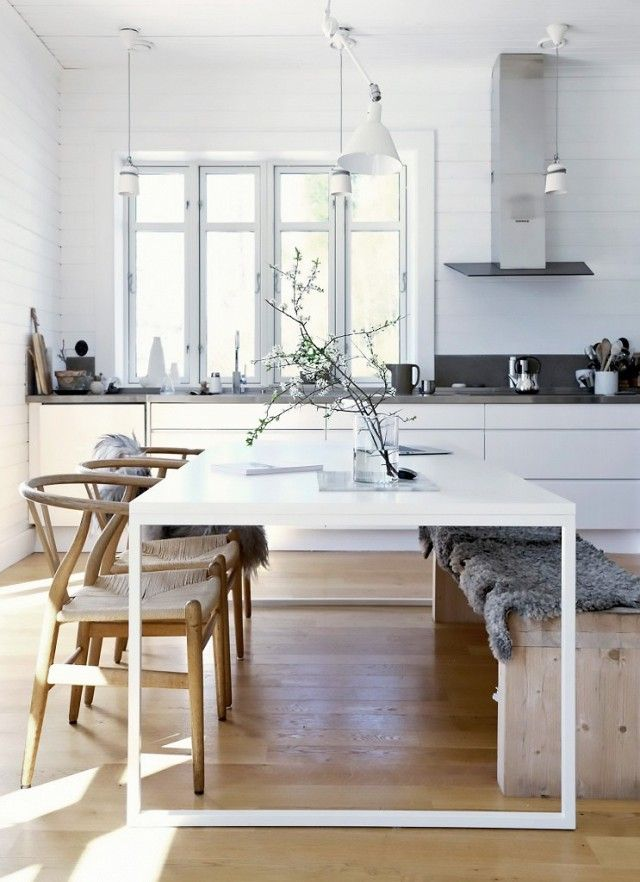 classic minimalistic dining table and kitchen