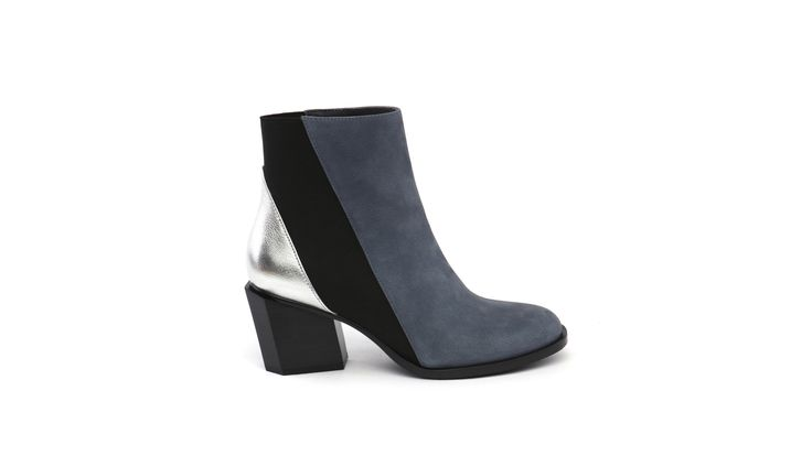 Inspired by geometry, the TETRA Mid is a minimal yet dynamic heel. Key silhouettes such as the round-squared toe and bold geometric heel are accompanied by a diagonal upper line. Leather stack covered heel, leather rand and textured rubber sole accentuate the geometry.  Indigo Tumbled Nubuck / Silver Tumbled Leather With Black Flat Elastic / Leather Lining / Leather Sock / Black Leather Stack Covered Heel / Rubber Outsole