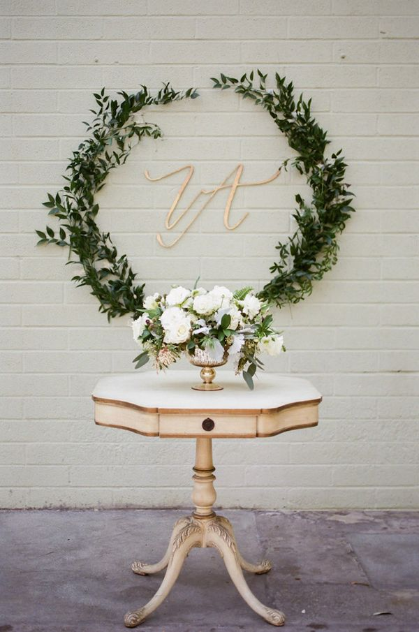 Garland of greenery framing initials for wedding detail
