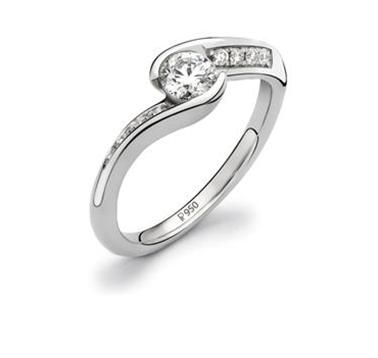 Prong set platinum solitaire ring complimented with channel set diamonds on the sides.