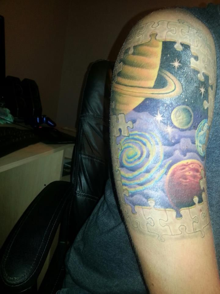 """My science tattoo! To me it sums on the Carl Sagan quote, We are all star stuff"""". The puzzlepiecesof the universe come together to form us (and everything else)."""