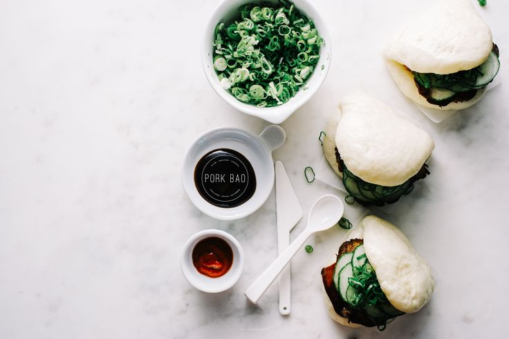 How to make chashu pork steamed bao – homemade steamed fold over bao buns stuffed with pork, cucumbers, and green onions.