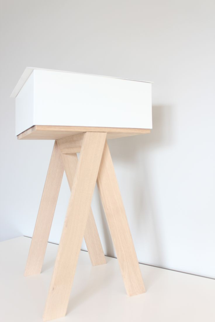"""HIDE"" by Mateusz Sipiora    Simple stool made from oak with steel chest."