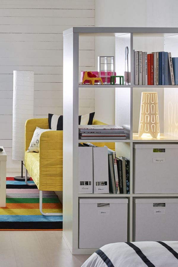 free use ikea kallax storage as a room divider that doubles to display your treasures or hide. Black Bedroom Furniture Sets. Home Design Ideas