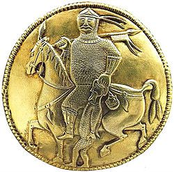 Warrior with captive, from a golden ewer of the Treasure of Nagyszentmiklós. There is no agreement as to whether he represents an Avar, a Bulgar or a Khazar warrior.