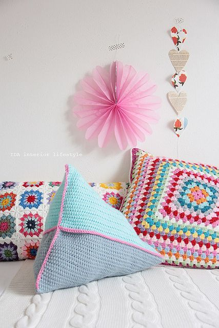 Today's 'crochet in the home' pic was found via Flickr.  It's a cushion extravaganza!  NEW PRODUCTS: *pyramid* cushion and *mots...