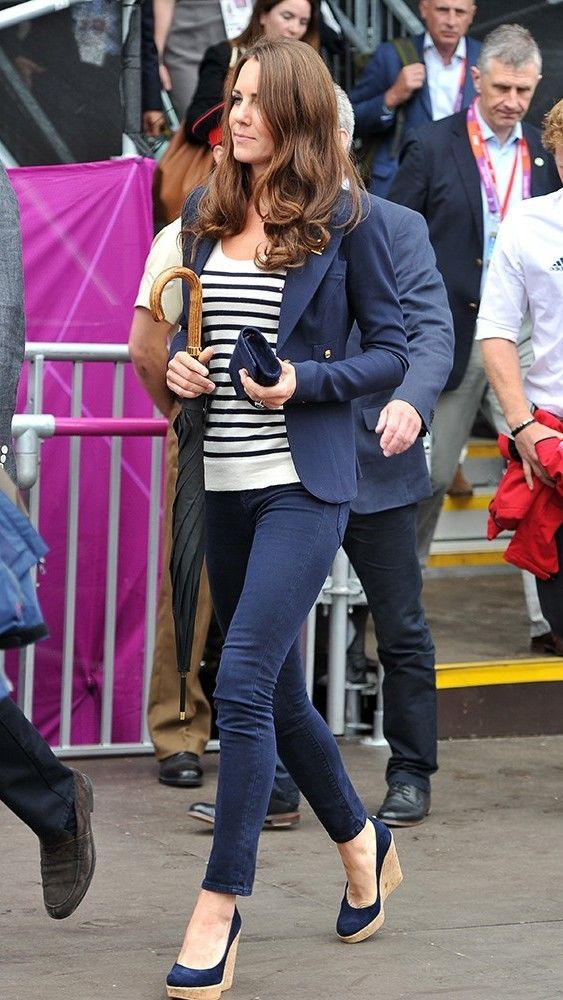 July 2012 | The Olympics took London by storm, and the young royals weren't going to miss it.  Kate sported UK colors in this striped top and navy jeans. via @stylelist