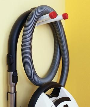we need a better solution for parking the vacuum so the hose doesn't make the whole thing topple over - I like this idea for the front hall closet: Organizations Clean, Vacuum Cleaners, Hose Hung, Vacuum Storage Closet, Biggest Challenges, Cleaners Hose, Front Hall Closet, Broom Closet, Clean Supplies