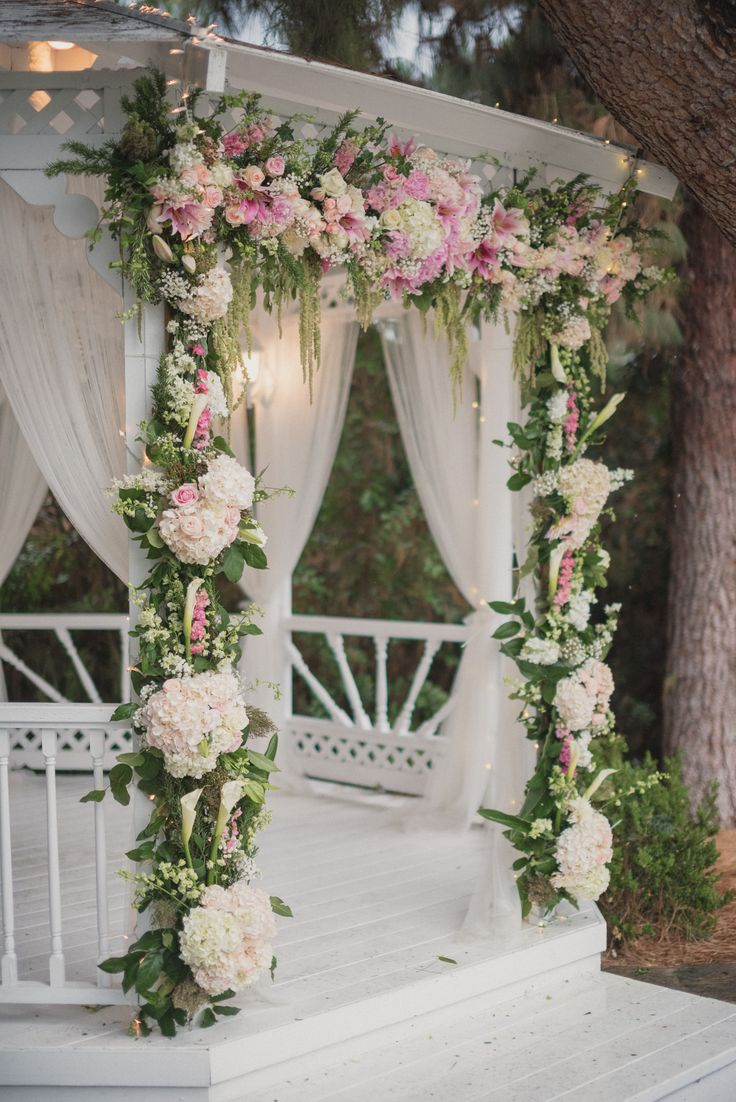White, pink, and blush flowers decorate white washed wedding ceremony gazebo at the Green Gable Wedding Estate. // Photo by Next to Me Studios