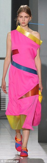 Accessorising: The collection was worn with multi-coloured flats and mini clutch bags...