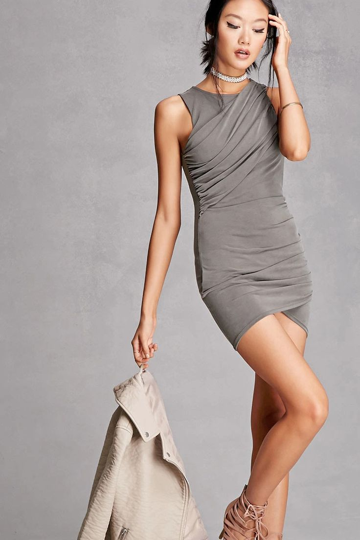 A slub knit bodycon dress featuring ruched sides, a round neckline, and a sleeveless cut. This is an independent brand and not a Forever 21 branded item.