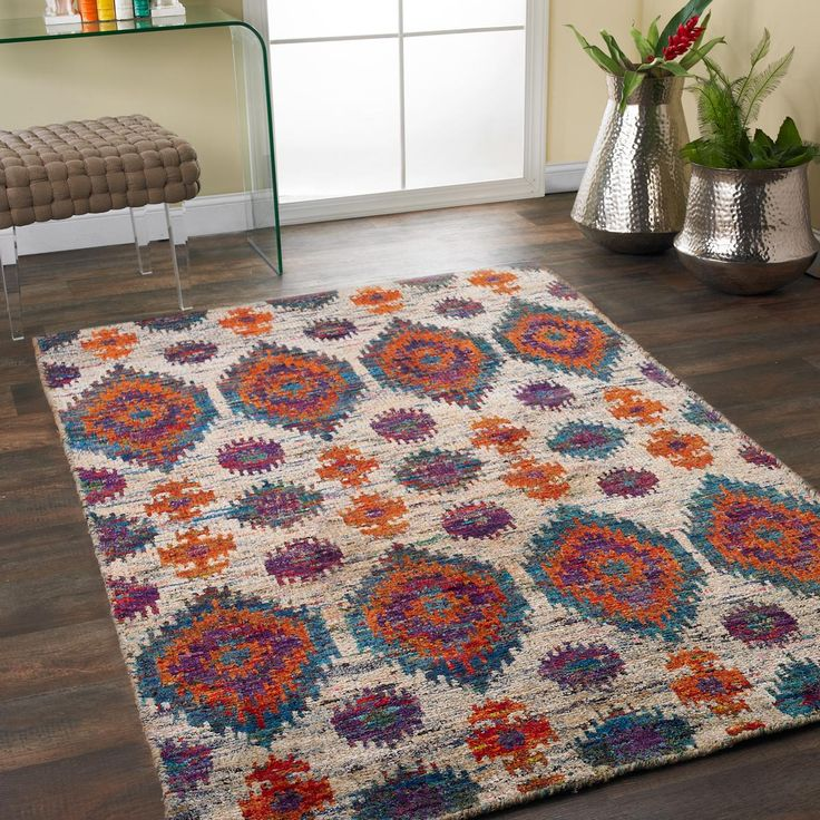 Multicolor Silk Bohemian Ikat Rug  With Bohemian chic flair, this colorful large scale Ikat rug is handmade from refurbished sari silks from India. Vibrant teal, orange and purple tones dominate the contemporary palette with a unique global appeal.