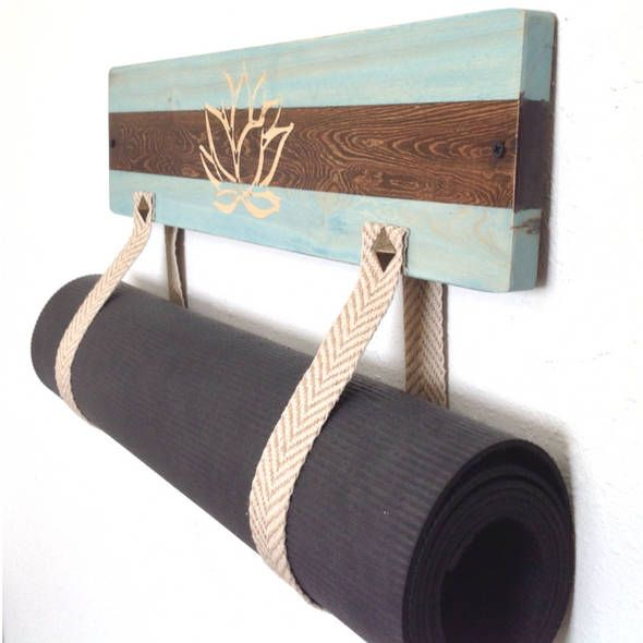 Yoga wall hanging. Are you looking for the newest style and unique yoga mat holder? Handmade and functional for your yoga studio or your home? A double-sided mat holder - Essentially what that means is, you can choose when you want to turn it around. Simply unscrew it from the wall and flip it ov