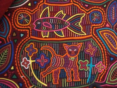 The traditional dress of Dule/Kuna women consists of a patterned blue cotton wrapped skirt, red & yellow headscarf, beaded cuffs & leggings, gold nose rings & earrings and the many layered and finely sewn mola panel blouse.    The artistry of a mola reflects a synthesis of traditional Dule culture with the influences of the modern world.  Mola art developed when Dule/Kuna women had access to store bought yard goods.