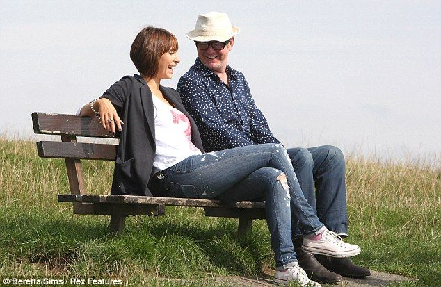 Day in the park: The One Show presenters Alex Jones and Chris Evans enjoy the sunshine on Hampstead Heath in between filming a segment for tomorrow's show