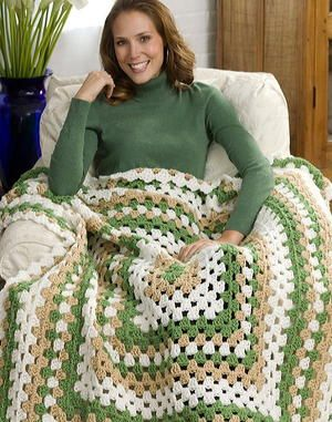 This takes the traditional granny square afghan to a whole new level! The three-color Weekend-Wonder Giant Granny Square Throw from Red Heart Yarn is made from the center out in one piece, so that there are no seams to sew once you finish.