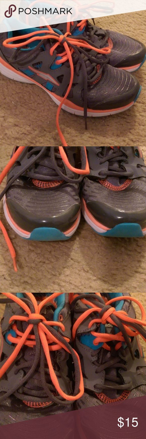 Size 8 Running Shoes Avia brand running shoes. Gray, Teal and bright orange. Double laces. Pre loved but in good condition. Has a few minor Mesh snags and the logo is rubbed off on the insoles. Size 8 Avia Shoes Athletic Shoes