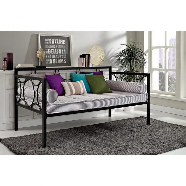 iron black daybed with beautiful cushions