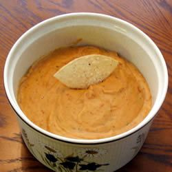 Ranch Bean Dip (1 (16 ounce) can refried beans 2 cups shredded Cheddar cheese 1 (1 ounce) package ranch dressing mix 1 cup sour cream)