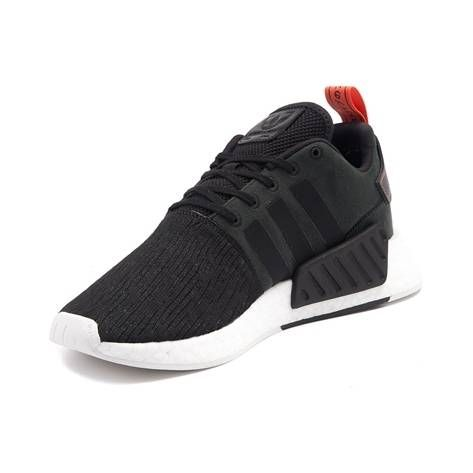 Sporting a progressive design with fresh new features, the new NMD R2 from adidas combines casual style with athletic functionality. The NMD R2 Athletic Shoe is primed for everyday wear, featuring a lightweight, stretch-knit upper with signature three stripe branding, sculpted Boost midsole with single EVA plug insert for energized stepping, finished off with a lightweight rubber tread outsole for premium traction and flexibility.