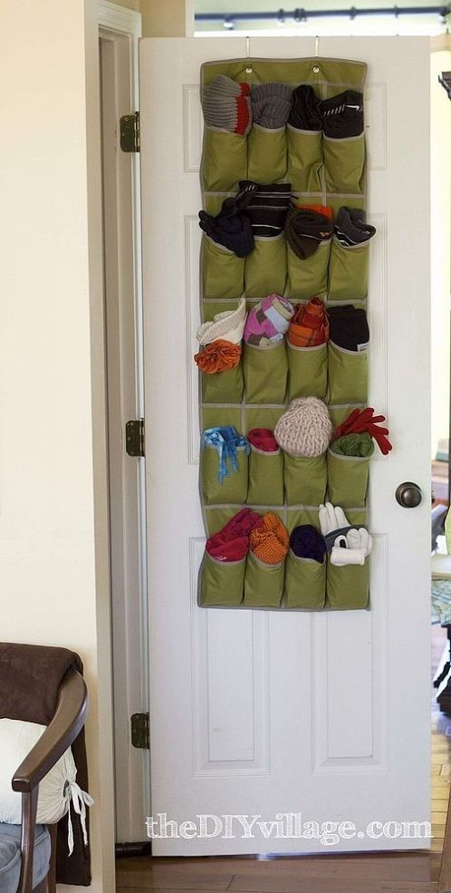 As the weather starts to turn bitter cold again, we love this trick of organizing winter accessories in a hanging shoe rack.