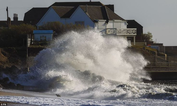Waves crash onto the beach at Selsey Bill near Chichester, West Sussex today... http://dailym.ai/1cRjxt5#i-aaa70e82