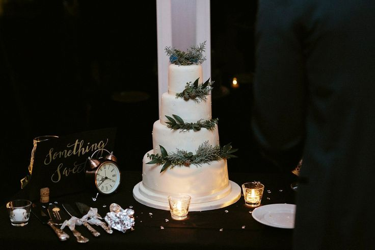 Four tier iced wedding cake. Photography by Ruth Atkinson